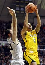 Valparaiso guard Tevonn Walker (2) shoots next to Purdue guard Dakota Mathias (31) during the first half of an NCAA college basketball game in West Lafayette, Ind., Thursday, Dec. 7, 2017. (AP Photo/Michael Conroy)