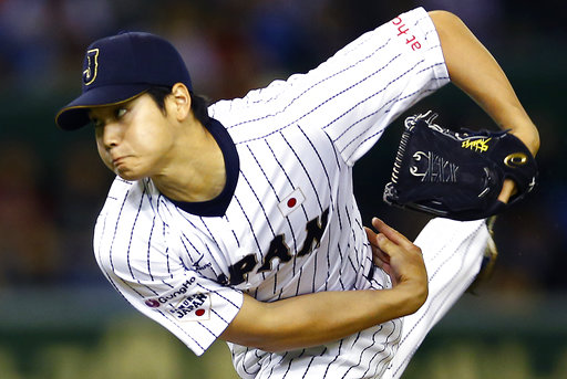 FILE - In this Nov. 19, 2015, file photo, Japan's starter Shohei Otani pitches against South Korea during the first inning of their semifinal game at the Premier12 world baseball tournament at Tokyo Dome in Tokyo. A person familiar with the decision says Major League Baseball owners on Friday, Dec. 1, 2017, have approved a new posting agreement with their Japanese counterparts in a move that allows bidding to start for coveted pitcher and outfielder Shohei Ohtani.   The person spoke on condition of anonymity because no announcement had been made. (AP Photo/Shizuo Kambayashi, File)