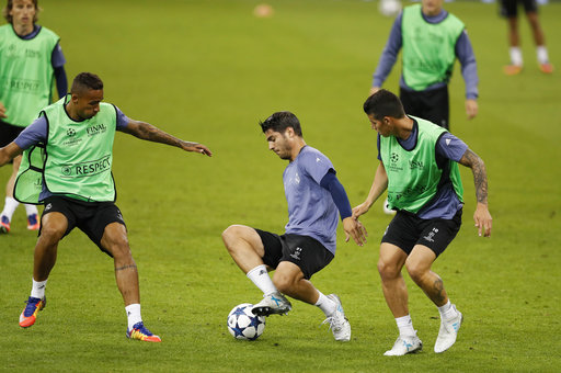 0d299e6ca58 Real Madrid s Isco controls a ball during a training session at the  Millennium Stadium in Cardiff