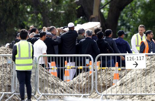 The Latest: Father, son are first mosque dead to be bur