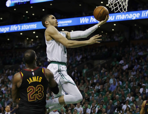 c835b5e9874 Boston Celtics forward Jayson Tatum (0) goes to the basket over Cleveland  Cavaliers forward LeBron James (23) during the fourth quarter of Game 5 of  the NBA ...