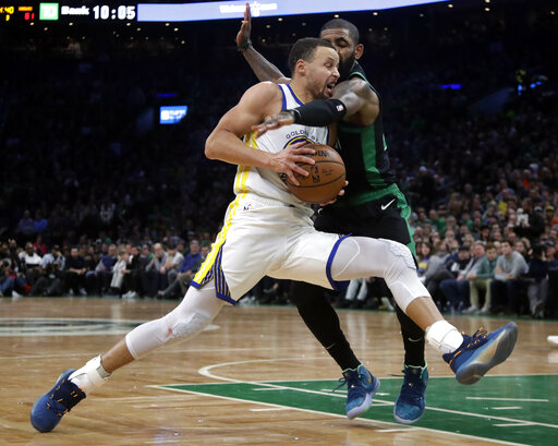 f639fdf4bd2 Golden State Warriors guard Stephen Curry drives against Boston Celtics  guard Kyrie Irving in the second half of an NBA basketball game Saturday