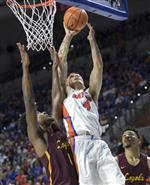 Florida guard Egor Koulechov (4) shoots over Loyola of Chicago guard Donte Ingram (0) during the second half of an NCAA college basketball game in Gainesville, Fla., Wednesday, Dec. 6, 2017. Loyola of Chicago won 65-59. (AP Photo/Ron Irby)