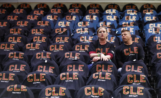 a29298746c5 Fans wait while surrounded by T-shirt-covered seats before Game 3 of  basketball's NBA Finals between the Cleveland Cavaliers and the Golden  State Warriors, ...