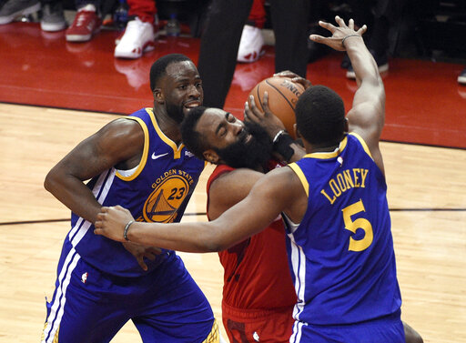 ab44829871f2 Golden State Warriors  Draymond Green (23) and Kevon Looney (5) defend  against Houston Rockets  James Harden (13) during the second half of Game 6  of a ...