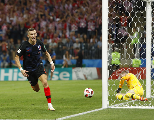 ae3cf96f6 Croatia s Ivan Perisic celebrates after scoring his side s first goal  during the semifinal match between Croatia and England at the 2018 soccer  World Cup in ...