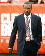 FILE - In this Sept. 1, 2016, file photo, Cleveland Browns acting vice president of football operations, Sashi Brown, walks the field during practice before an NFL preseason football game against the Chicago Bears, in Cleveland. A person familiar with the decisions says the Cleveland Browns have fired Sashi Brown, the club's vice president of football operations. Brown, who was named the team's top executive by owners Dee and Jimmy Haslam during an overhaul following the 2015 season, was relieved of his duties on Thursday, Dec. 7, 2017, said the person who spoke to the Associated Press on condition of anonymity because the team has not announced the move. (AP Photo/Ron Schwane, File)