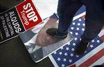 A Palestinian steps on a poster of U.S. President Donald Trump and a representation of the American flag during a protest against the U.S. decision to recognize Jerusalem as Israel's capital, in Gaza City Thursday, Dec. 7, 2017. (AP Photo/ Khalil Hamra)