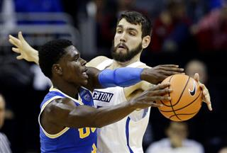 Manny Suarez, Aaron Holiday