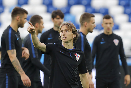 0624ea627 Croatia s Luka Modric points up during official training on the eve of the  group D match between Croatia and Nigeria at the 2018 soccer World Cup in  the ...