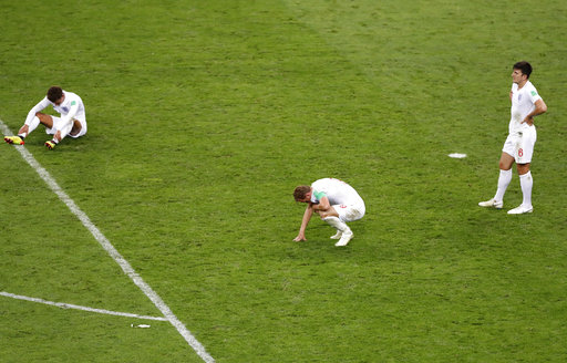3cdfb98f41f England players react on the pitch disappointed after losing the semifinal  match between Croatia and England at the 2018 soccer World Cup in the  Luzhniki ...