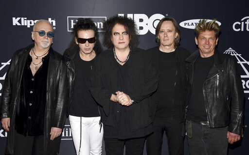 95fcf0334 Reeves Gabrels, from left, Simon Gallup, Robert Smith, Roger O'Donnell and  Jason Cooper, of The Cure, arrive at the Rock & Roll Hall of Fame induction  ...