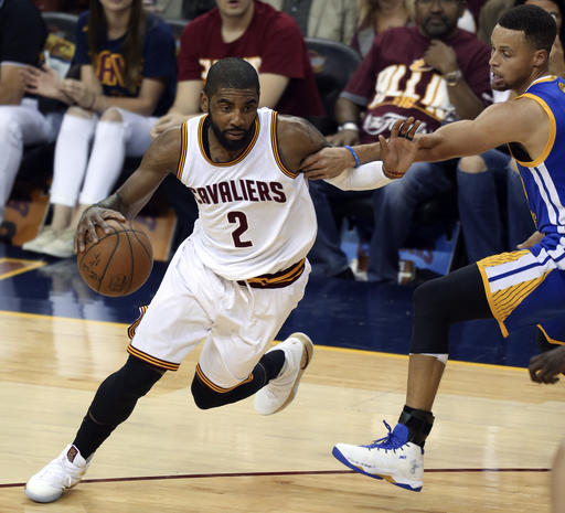 f3c17a677c15 Cleveland Cavaliers guard Kyrie Irving (2) drives on Golden State Warriors  guard Stephen Curry during the first half of Game 3 of basketball s NBA  Finals in ...