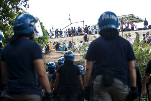Rome police evict Italian, migrant squatters from ex-sc
