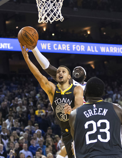 d6ba21aa161 Golden State Warriors guard Stephen Curry (30) scores the final basket  against the Los Angeles Clippers in the fourth quarter of an NBA basketball  game