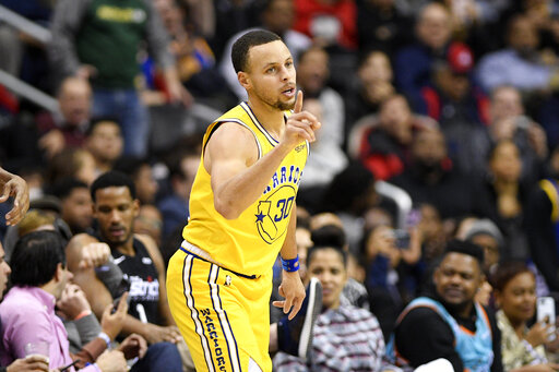 f0f35ad484d Golden State Warriors guard Stephen Curry gestures during the second half  of the team s NBA basketball game against the Washington Wizards
