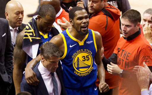 419dd752efb ... Kevin Durant (35) reacts as he leaves the court after sustaining an  injury during first-half basketball action against the Toronto Raptors in  Game 5 of ...