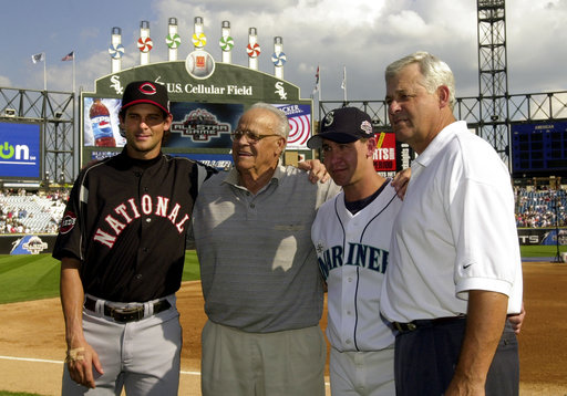 In this  July 15, 2003  file photo, then-Cincinnati Reds' Aaron Boone, left, and his brother, Bret, second from right, pose with their grandfather, Ray, second from left, and father, Bob, right, before the 74th Major League Baseball All-Star Game at U.S. Cellular Field in Chicago. Aaron Boone's hiring has been finalized by the New York Yankees, who gave the ESPN broadcaster a three-year contract to succeed Joe Girardi as manager, Monday, Dec. 4, 2017. New York said he will be introduced Wednesday at Yankee Stadium. (AP Photo/Mark Duncan, File)
