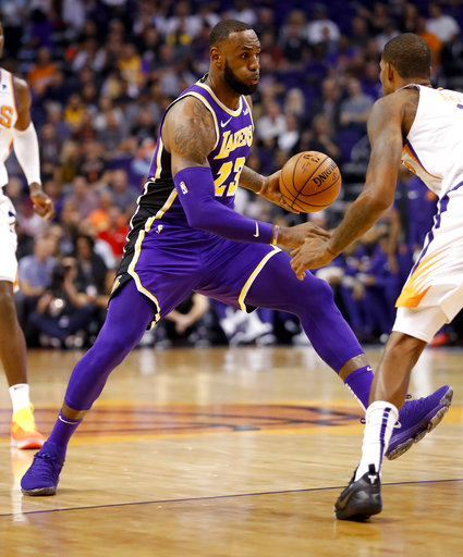 405c2bb53f3 Los Angeles Lakers forward LeBron James (23) drives past Phoenix Suns  forward Trevor Ariza during the first half of an NBA basketball game