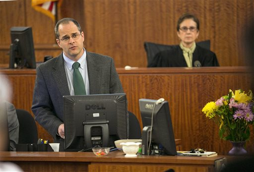 Clerk Mark Ferreira polls the jury on the verdict for former NFL player Aaron Hernandez during his murder trial at the Bristol County Superior Court in Fall River