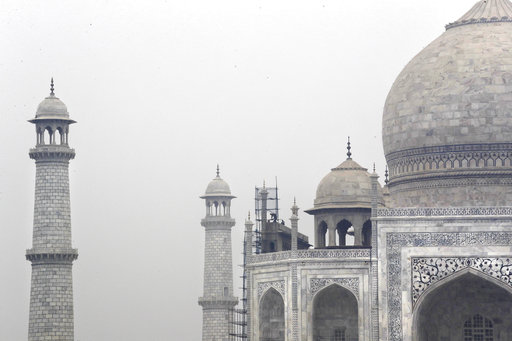 In this Tuesday, Dec. 5, 2017, photo, Indian workers clean the discoloration of the Taj Mahal caused by environmental pollution in Agra, India. Authorities in India are trying to figure out how workers will scale the Taj Mahal's majestic but delicate dome as they complete the first thorough cleaning of the World Heritage site since it was built 369 years ago. Work on the mausoleum's minarets and walls is almost finished, after workers began the makeover in mid-2015. They've been using a natural mud paste to remove yellow discoloration and return the marble to its original brilliant white. Called fuller's earth, it's the same clay that some people smother on their skin as a beauty treatment. (AP Photo/Manish Swarup)