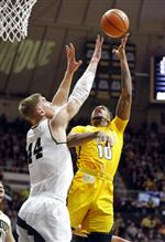 Valparaiso guard Joe Burton (10) shoots over Purdue center Isaac Haas (44) during the first half of an NCAA college basketball game in West Lafayette, Ind., Thursday, Dec. 7, 2017. (AP Photo/Michael Conroy)