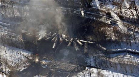 FILE-This aerial Feb. 17, 2015 file photo photo made available by the Office of the Governor of West Virginia shows a derailed train in Mount Carbon, WVa. As investigators in West Virginia and Ontario pick through the wreckage from the latest pair of oil train derailments to result in massive fires, U.S. transportation officials predict many more catastrophic wrecks involving flammable fuels in coming years absent new regulations. (AP Photo/ Office of the Governor of West Virginia, Steven Wayne Rotsch,File)