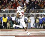 FILE - In this Dec. 1, 2017, file photo, Stanford running back Bryce Love (20) celebrates after scoring a touchdown against Southern California during the first half of the Pac-12 Conference championship NCAA college football game in Santa Clara, Calif. Love was selected to the AP All-Conference Pac-12 team announced Thursday, Dec. 7, 2017. (AP Photo/Marcio Jose Sanchez, File)