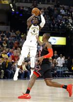 Indiana Pacers guard Victor Oladipo (4) hits a shot over Chicago Bulls guard Kris Dunn (32) to give the Pacers the lead in the final minute of an NBA basketball game in Indianapolis, Wednesday, Dec. 6, 2017. The Pacers defeated the Bulls 98-96. (AP Photo/Michael Conroy)