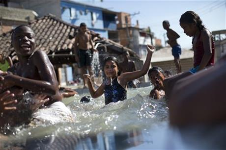 APTOPIX Brazil Rio 2016 Filthy Waters Slums