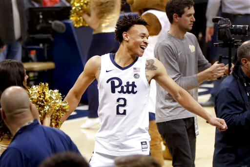 2054596d6ae Pittsburgh s Trey McGowens (2) looks back for teammates as he celebrates  while leaving the court after defeating number 11 Florida State in an NCAA  college ...