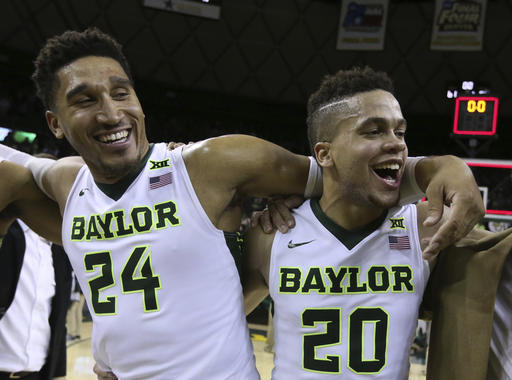 reputable site f2015 c9c6f Baylor guard Ishmail Wainright, left, and guard Manu Lecomte, right  celebrate following their game with Oklahoma State after an NCAA college  basketball game ...