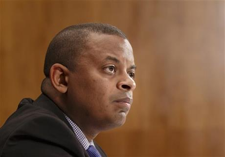 """FILE - This March 13, 2014 file photo shows Transportation Secretary Anthony Foxx on Capitol Hill in Washington. The Transportation Department issued an emergency order on May 7 requiring that railroads inform state emergency management officials before moving large shipments of crude oil through their states, and urged railroads not to use older model tanks cars that are easily ruptured in accidents, even at slow speeds. """"All options are on the table when it comes to improving the safe transportation of crude oil, and today's actions, the latest in a series that make up an expansive strategy, will ensure that communities are more informed and that companies are using the strongest possible tank cars,"""" Foxx said in a statement. (AP Photo/J. Scott Applewhite, File)"""