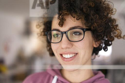 Portrait Of A Young Woman With Curly Hair Wearing Glasses