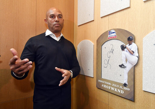 cda05a9e5 Baseball Hall of Fame inductee Mariano Rivera speaks after signing the  backer board where his plaque will hang while visiting the National  Baseball Hall of ...