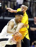 Purdue forward Vincent Edwards (12) tries to gets through the defense of Valparaiso center Jaume Sorolla (14) during the first half of an NCAA college basketball game in West Lafayette, Ind., Thursday, Dec. 7, 2017. (AP Photo/Michael Conroy)