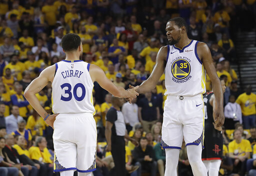 7a86c9f03ee3 Golden State Warriors guard Stephen Curry (30) reacts with forward Kevin  Durant (35) during the first half of Game 1 of a second-round NBA  basketball ...