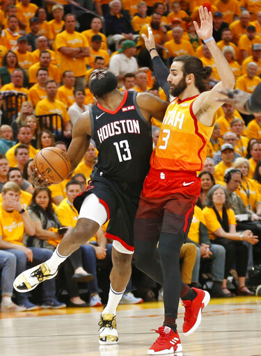 7873a292fef Utah Jazz guard Ricky Rubio (3) fouls Houston Rockets guard James Harden  (13) as he drives in the first half during an NBA basketball game Saturday,  ...