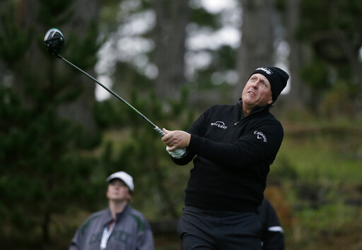 5dabce26ca Wild finish for Mickelson, wet one for Spieth at Pebble   AccessWDUN.com