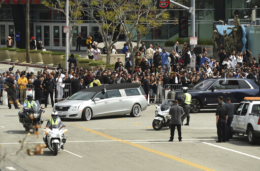 The Latest: Nipsey Hussle procession pauses at rapper's