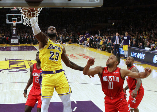 Los Angeles Lakers  LeBron James (23) dunks past Houston Rockets  Eric  Gordon (10) during the second half of an NBA basketball game Thursday 2dbd486c8