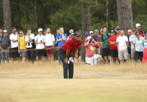 cc35478a731a9b The Latest  Woods drops out of lead at British Open