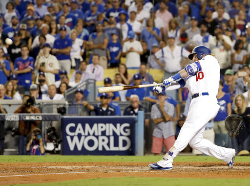 Turner homers in 9th, Dodgers top Cubs 4-1 for 2-0 NLCS
