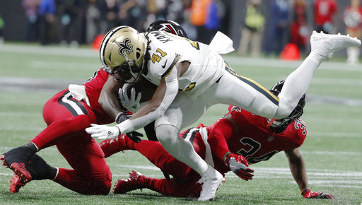 Atlanta Falcons middle linebacker Deion Jones (45) hits New Orleans Saints running back Alvin Kamara (41) during the first half of an NFL football game, Thursday, Dec. 7, 2017, in Atlanta. (AP Photo/David Goldman)
