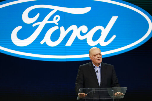 Seeing a twisting road ahead, Ford cuts 7K white-collar