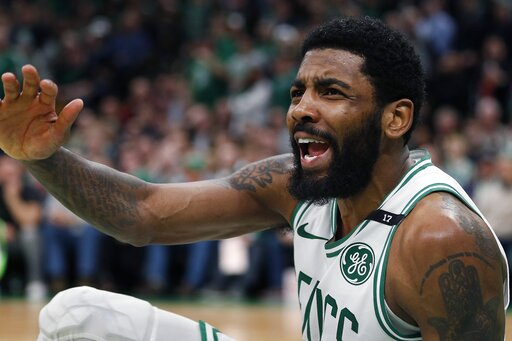 05a12d776a4 Boston Celtics  Kyrie Irving looks for a foul call against the Milwaukee  Bucks after attempting a shot during the second half of Game 3 of a second  round ...