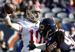 FILE - In this Sunday, Dec. 3, 2017, file photo, San Francisco 49ers quarterback Jimmy Garoppolo (10) throws a pass during the first half of an NFL football game against the Chicago Bears in Chicago. Garoppolo looks to follow up a successful first start for the 49ers with another this week against Houston. (AP Photo/Nam Y. Huh, File)